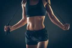 Sport, activity. Cute woman with skipping rope Royalty Free Stock Images