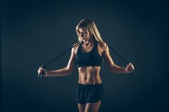 Sport, activity. Cute woman with skipping rope Stock Images