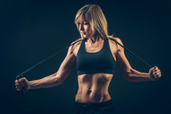 Sport, activity. Cute woman with skipping rope Stock Image