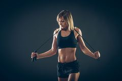 Sport, activity. Cute woman with skipping rope Royalty Free Stock Photo