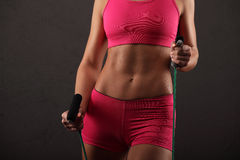 Sport, activity. Cute woman with skipping rope. Muscular Royalty Free Stock Photo