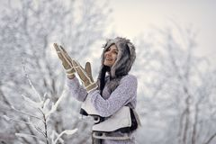 Sport, activity, health. Happy woman smile with figure skates at trees in snow. Vacation, holidays, hobby, lifestyle. Ice skating concept. Girl with skating stock photography