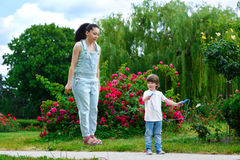 Sport activity lifestyle concept. Cute woman and. Sport and activity lifestyle concept. Cute women and son with skipping ropes royalty free stock photos