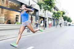 Sport african woman running in the street, motion blurred effec Royalty Free Stock Image