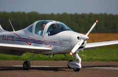 Sport aircraft moves along a taxiway to the runway. Airfield Severka, Moskow region, Russian Federation Stock Photos
