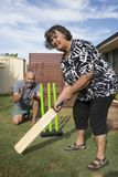 Sport for all Ages. Backyard Cricket, an Aussie tradition for the whole family. A version of the international sport with many varying local rules royalty free stock image