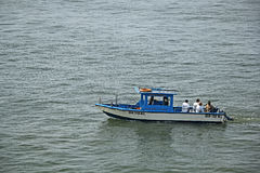 Sport Anglers in Boat. Dona Paula, Goa, India - February 10, 2017: Unidentified sport anglers in boat on an angling trip in the sea around Dona Paula in Goa royalty free stock photo