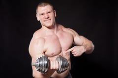 Sport the athlete bodybuilder build muscles dumbbells Stock Photo