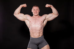 Sport the athlete bodybuilder shows off his muscles stock image
