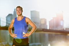 Sport athlete man runner - New York City skyline. Sport athlete man running portrait in New York City - Brooklyn Bridge and Manhattan skyline in background royalty free stock images