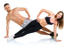 Sport attractive couple - man and woman doing fitness exercises Stock Images