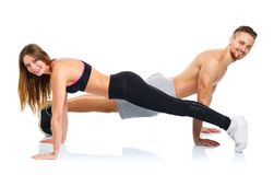 Sport attractive couple - man and woman doing fitness exercises Stock Photos