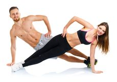 Sport attractive couple - man and woman doing fitness exercises Royalty Free Stock Images