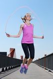 Sport. Attractive girl with skipping rope Royalty Free Stock Photography