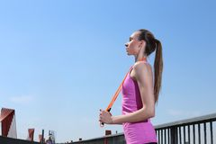 Sport. Attractive girl with skipping rope Stock Photo