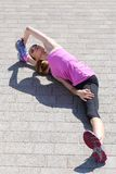 Sport. Attractive girl on the street. Sport, activity. Cute woman during warm-up Royalty Free Stock Photography