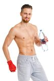 Sport attractive man wearing boxing bandages with bottle of wate Royalty Free Stock Photos