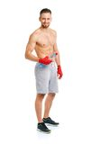 Sport attractive man wearing boxing bandages with bottle of wate Stock Photos