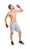 Sport attractive man wearing boxing bandages with bottle of wate Royalty Free Stock Images