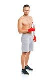 Sport attractive man wearing boxing bandages with bottle of wate Stock Image