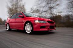 Sport-Auto, unscharfe Bewegung Stockfoto
