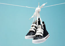 Sport baby shoes. Hanging on the rope Royalty Free Stock Image