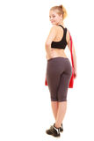 Sport. Back of fitness sporty girl in sportswear with gym bag Royalty Free Stock Photography