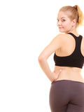 Sport. Back of fitness sporty girl in sportswear isolated Stock Photography