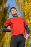 Sport back injury. Male athlete suffering from severe back pain. Caucasian sportsman showing his physical pain royalty free stock photo