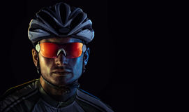 Cyclist. Dramatic close-up portrait royalty free stock photography