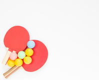 Sport background. Red ping-pong rackets and varicolored balls. Flat lay, top view. Stock Photo
