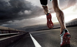 Sport background. Runner. Runner feet running on road closeup on shoe stock images