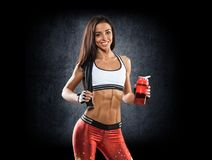 Sports. Woman at the gym doing stretching exercises and smiling Stock Photography