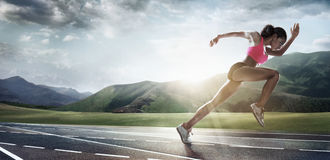 Sport backgrounds. Runner. Dramatic scene Stock Photos