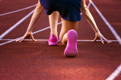 Sport backgrounds. Sprinter starting on the running track. Dramatic image. Red running track with female runner stock photos