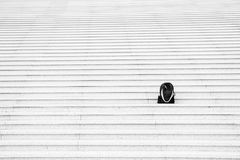 Sport bag on stairs. Black backpack outdoor. Beauty and fashion. Success and loneliness. Traveling and vacation, copy space Stock Images