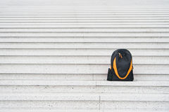Sport bag on stairs. Stock Photo