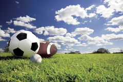 Sport balls. Baseball,Soccer Ball and Football on grass Royalty Free Stock Photography