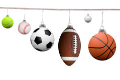 Sport balls on a clothesline Royalty Free Stock Image
