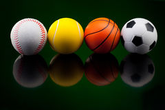 Sport  balls in front of black background Royalty Free Stock Photo