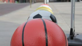 Sport Balls. Row of huge sports balls including a basketball, a soccer ball, a tennis ball and a golf ball Royalty Free Stock Images