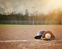 Sport Baseball Background with Copyspace Area. A baseball background with copyspace to add your message or player with a baseball mitt and helmet on the ground Royalty Free Stock Image