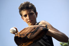 Sport, baseball and kids, portrait of child throwing ball. Sport, baseball and kids, portrait of child with glove holding ball and looking at camera Royalty Free Stock Photos