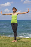 Sport on the beach. Woman on the beach doing sport exercises Stock Photo