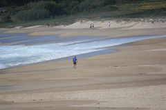 Sport in beach. Running in beach of Galicia, Spain Stock Photos