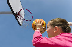 Sport beautifull girl shooting basket ball Stock Photos