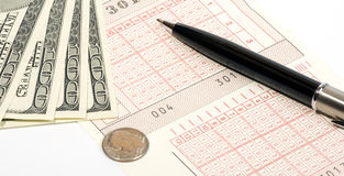 Sport betting. Sports betting slip, pen and money Stock Photo