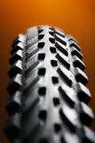 Bicycle tire on the orange Stock Images
