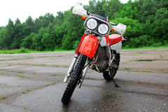 Sport bike. Red sport motocross bike outdoors Royalty Free Stock Photos