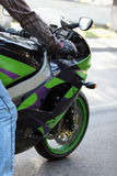Sport bike. Sport bike is green, on a city street Stock Image